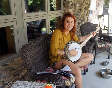 Abbey playing banjo