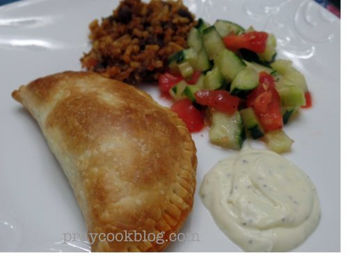 Plate Empanada and cuc tom salad